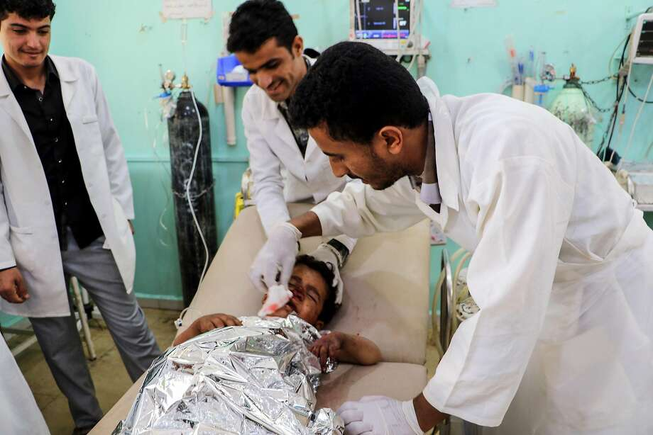 Medics treat a child who was injured in an air strike on a rebel stronghold in Saada province in Yemen. Photo: AFP / Getty Images