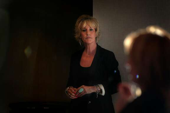 Erin Brokovich listens as Noreen Evans, former state senator, speaks during a press conference about PG&E's culpability for the Wine Country Fires in 2017 at the Hyatt Regency in San Francisco, Calif., on Monday, July 9, 2018. Brockovich has gotten involved in some of the lawsuits against PG&E over last fall's Wine Country wildfires. She and former state senator Evans delivered a letter to PG&E's CEO asking the company to stop trying to make its customers pay the costs of settling lawsuits from the fires.