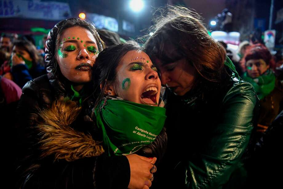 Activists in favor of legalizing abortion in Argentina react outside the National Congress in Buenos Aires after the Senate rejected a bill that would have decriminalized the procedure. Photo: Eitan Abramovich / AFP / Getty Images