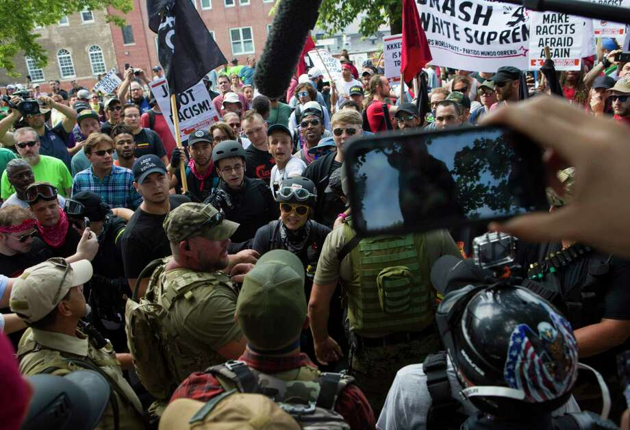 Protesters and counter-protesters clash during a Unite the Right rally on Aug. 12, 2017, in Charlottesville, Va. Photo: Washington Post Photo By Calla Kessler / The Washington Post