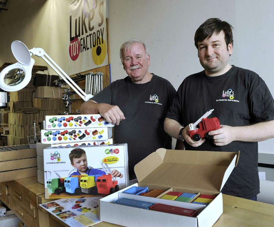 James Barber and son Luke of Luke's Toy Factory in Danbury, Tuesday, August 7, 2018. The packaging is made specifically for their European market. Photo: Carol Kaliff / Hearst Connecticut Media / The News-Times
