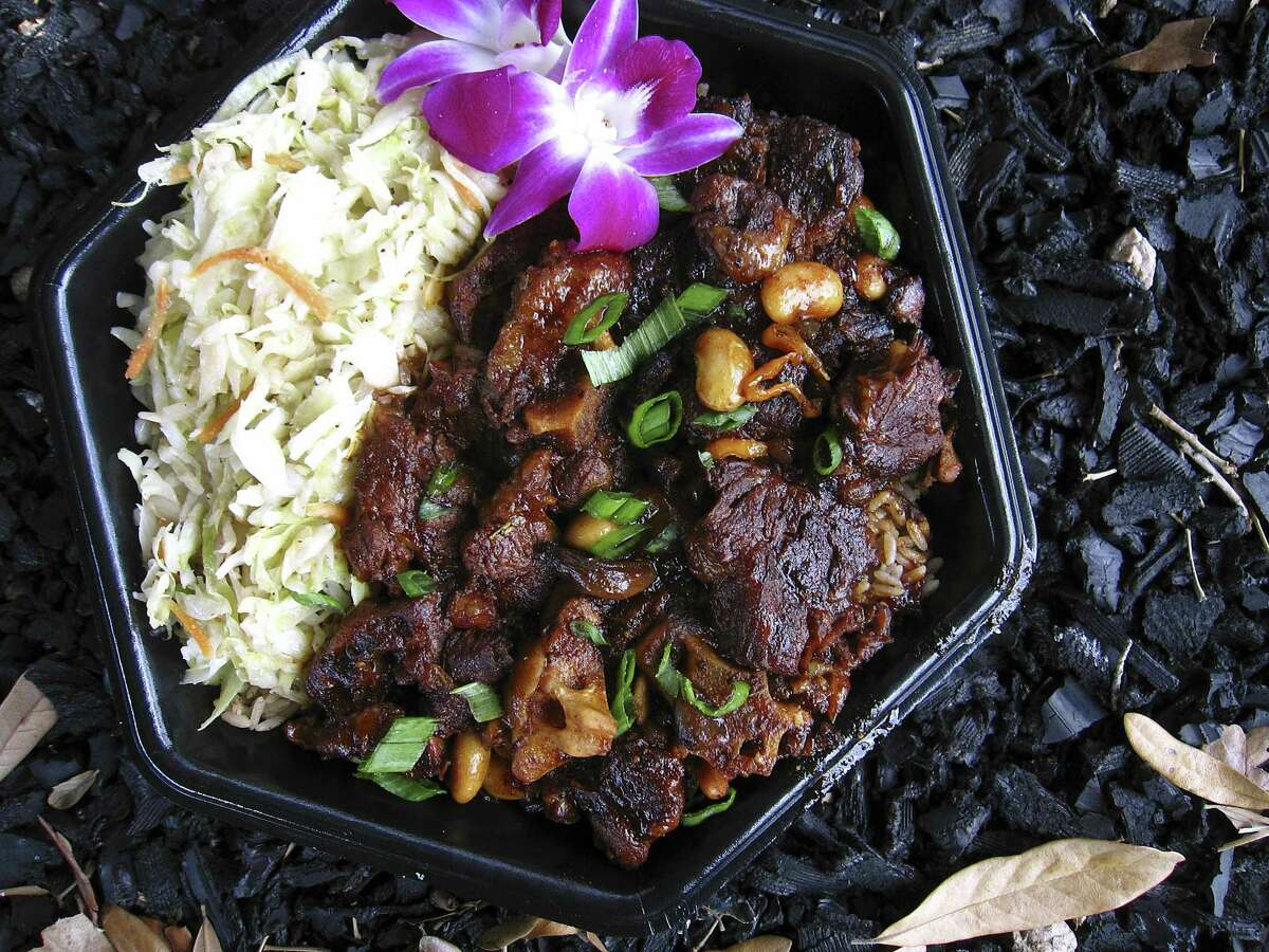 Braised oxtails with sauteed cabbage and rice and peas from The Jerk Shack