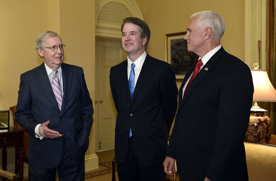 Brett Kavanaugh (center) meets with Sen. Mitch McConnell (left) and Vice President Mike Pence after his nomination to the Supreme Court in June. Photo: Susan Walsh / Associated Press