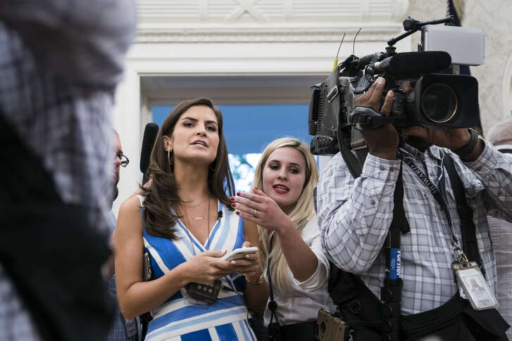 WASHINGTON, DC - JULY 30 : CNN White House Correspondent Kaitlan Collins asks questions of President Donald J. Trump as the press is escorted out after a swearing-in ceremony for the new Secretary of the Department of Veterans Affairs Robert Wilkie in the Oval Office at the White House on Monday, July 30, 2018 in Washington, DC. (Photo by Jabin Botsford/The Washington Post via Getty Images)