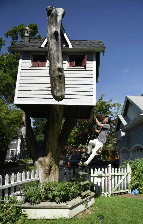 Zan Ng climbs into the 30-year-old treehouse outside his home on Orchard Street in the Cos Cob section of Greenwich, Conn. Thursday, Aug. 2, 2018. Photo: Tyler Sizemore / Hearst Connecticut Media / Greenwich Time