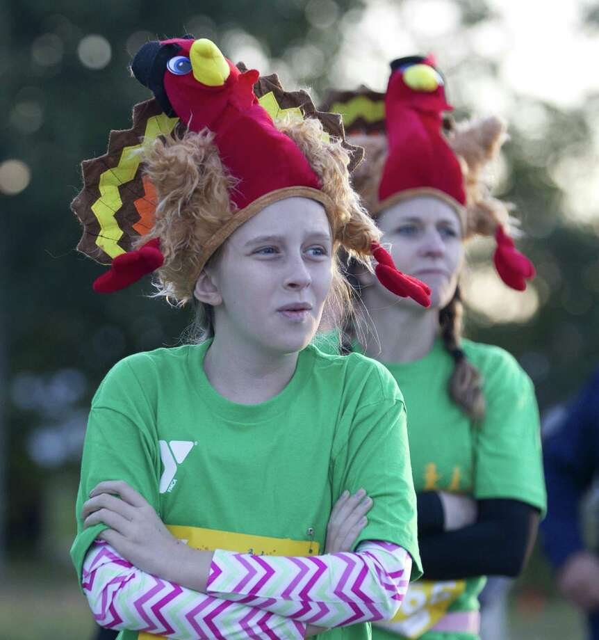 The Miller family wears festival headwear before taking part in the annual YMCA Run Thru the Woods on Thanksgiving, Thursday, Nov. 23, 2017, in The Woodlands. Photo: Jason Fochtman, Staff Photographer / Houston Chronicle / © 2017 Houston Chronicle