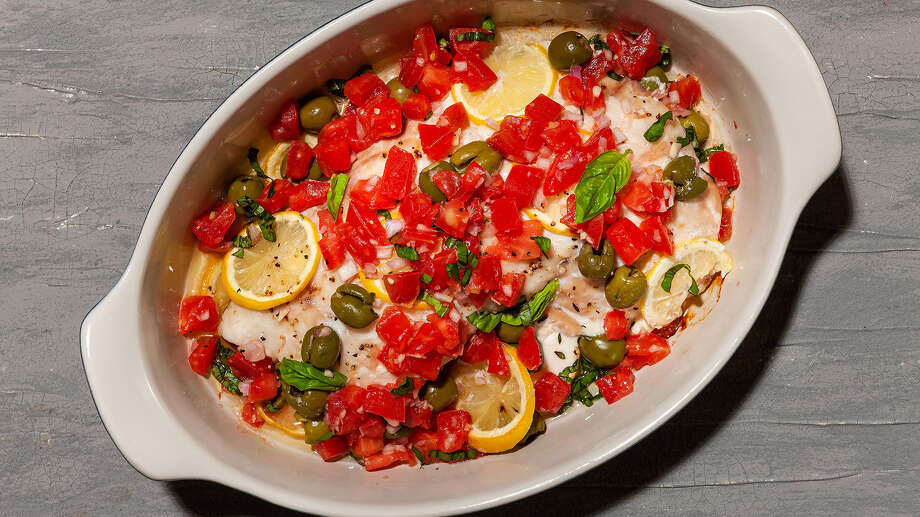 Slow-Roasted Snapper With Olive and Tomato Salad. Photo: Photo By Goran Kosanovic For The Washington Post. Food Styling By The Washington Post's Bonnie S. Benwick. / For The Washington Post