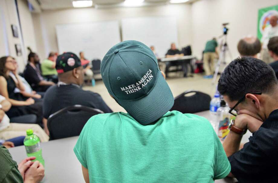 "David Yung Ho Kim sports a ""Make America Think Again"" hat at the Green Party's annual national convention, in Salt Lake City, July 19, 2018. Though young liberal activists have energized a Democratic Party that increasingly echoes the green agenda on health care, campaign finance and more, the Greens will field at least 224 candidates this November. (Kim Raff/The New York Times) Photo: KIM RAFF, STR / NYT / NYTNS"