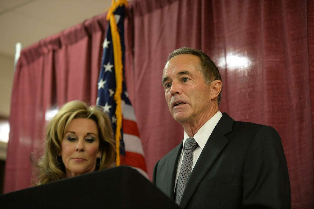 BUFFALO, NY - AUGUST 08: U.S. Rep. Chris Collins (R-NY), with his wife Mary at his side, holds a news conference in response to his arrest for insider trading on August 8, 2018 in Buffalo, New York. Collins, along with son Cameron Collins and his fiancé's father Stephen Zarsky, were arraigned today in Manhattan federal court on charges of insider trading, conspiracy to commit fraud, and lying to federal officials. (Photo by John Normile/Getty Images)