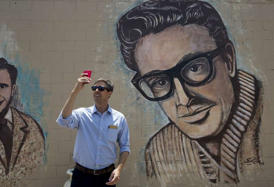 Beto O'Rourke conducts a livestream in front of a Buddy Holly mural on 19th Street Tuesday, July 31, 2018, in Lubbock, Texas. O'Rourke made a quick stop by the mural as he and his wife left the city following the town hall at the Cactus Theater. Photo: Godofredo A. Vasquez/Houston Chronicle