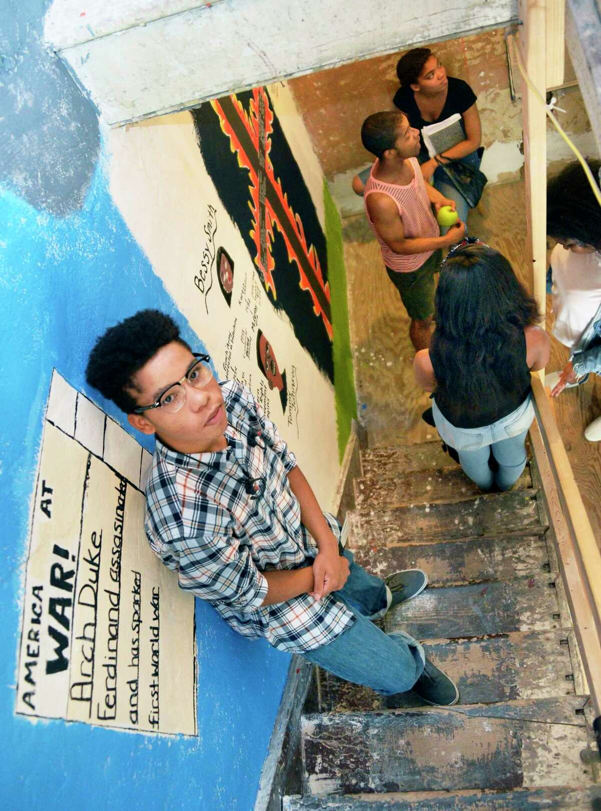 Joshua Sifontes, 16, next to his portion of a mural tribute to black history in America running along the staircase of the historic Stephen and Harriet Myers Residence Thursday August 9, 2018 in Albany, NY. (John Carl D'Annibale/Times Union)