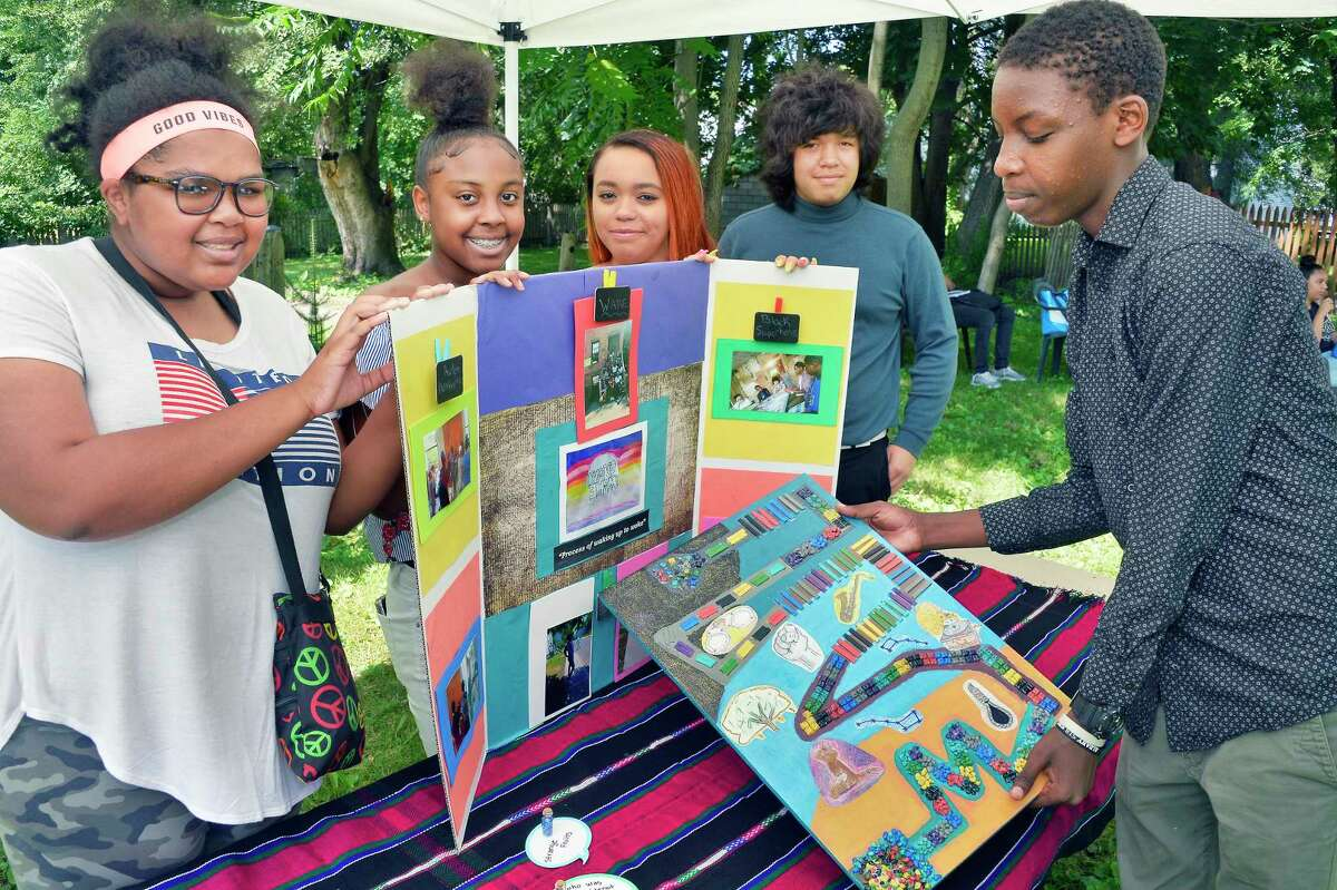 Members of the board game team, from left, Janise Ebron-Davis, 15, Niyana Daniels, 14, Alisha Deer, 16, Nicholas Koopman, 15, and Enoch Rwigenza, 15, during the summer program at the historic Stephen and Harriet Myers Residence Thursday August 9, 2018 in Albany, NY. (John Carl D'Annibale/Times Union)