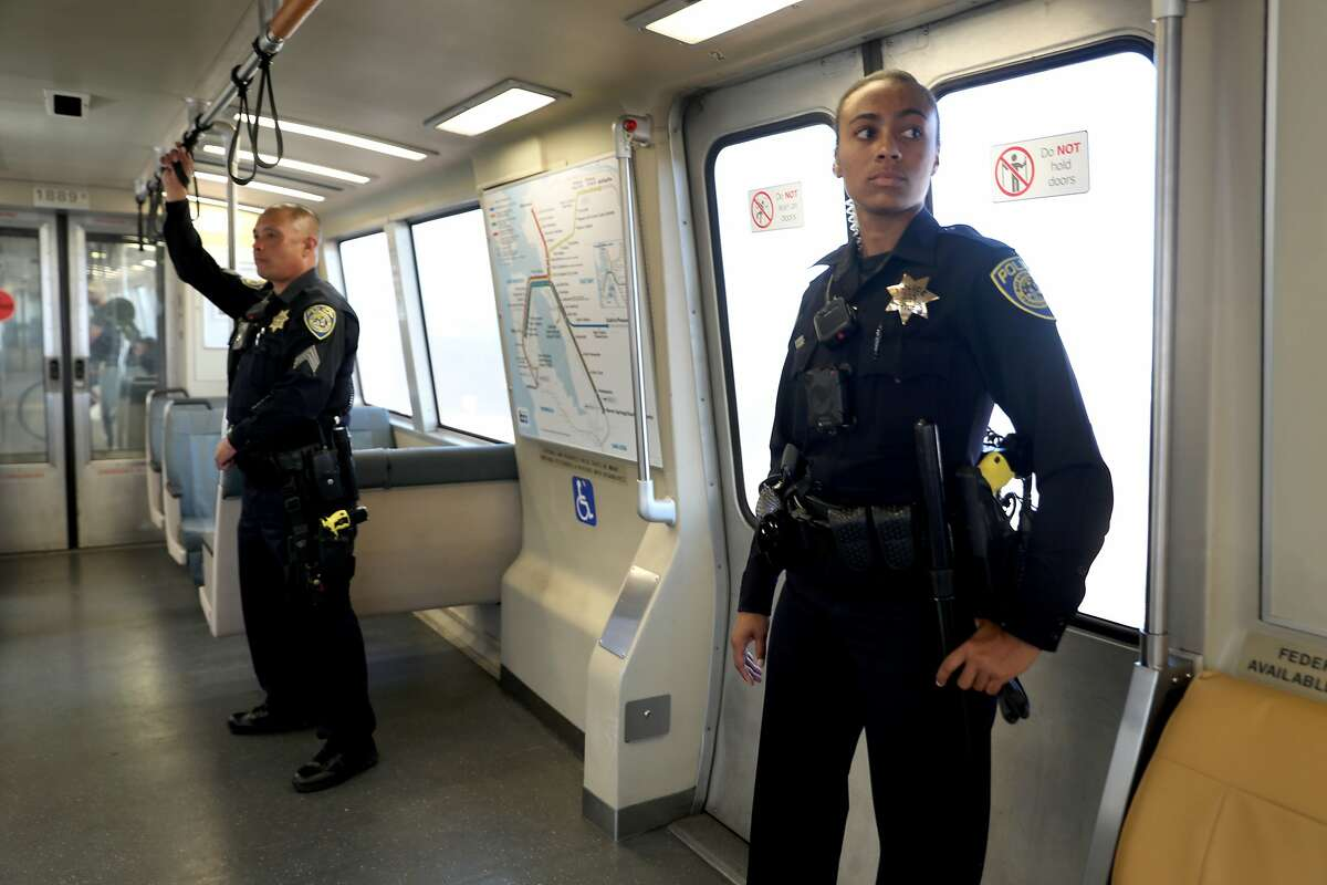 Sergeant Togonon (left) and BART officer Cunningham (right) ride BART from West Oakland station as they start a new public safety plan for the system following a string of high-profile stabbings on Monday, Aug. 6, 2018 in Oakland, Calif. At right is officer Cunningham.