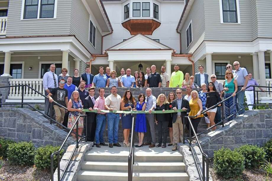 Members of the Saratoga County Chamber of Commerce and Bonacio Construction celebrated a ribbon cutting Aug. 7 at the company's latest condo project in Saratoga Springs. (Photo provided)