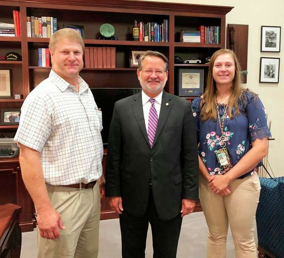 Harbor Beach dairy farmers Darrin and McKenna Wolschleger met with Senator Gary Peters, center, during their recent visit to Washington, D.C. The Wolschlegers discussed issues impacting the dairy industry with congressional leaders. (Submitted Photo)