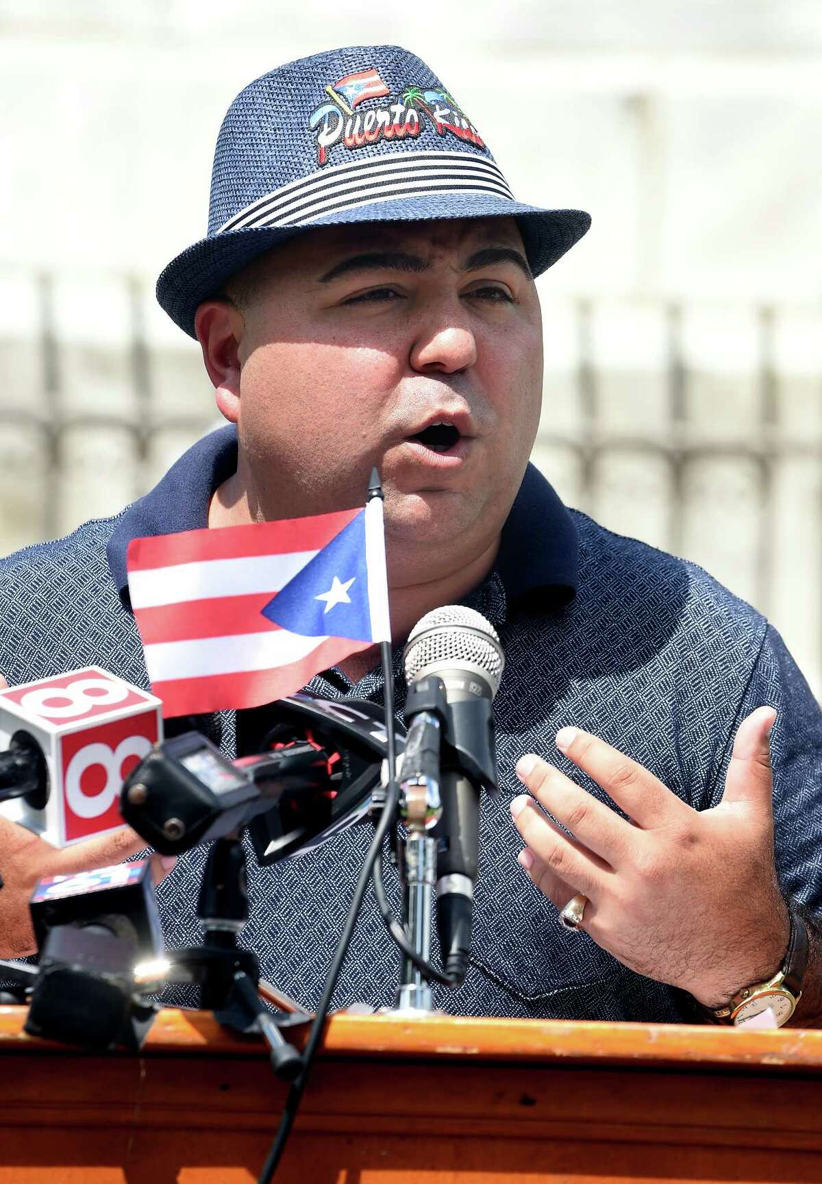 FILE - Joe Rodriguez, president of Puerto Ricans United-Puerto Rican Festival of New Haven, speaks before the Puerto Rican flag is raised on the New Haven Green on August 9, 2018 in honor of the Third Annual New Haven Puerto Rican Festival.