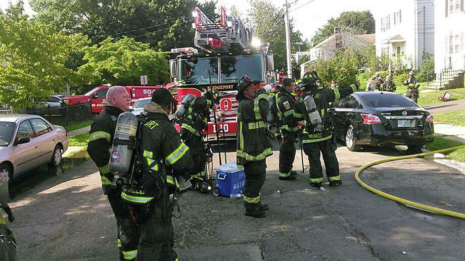 Around 8:50 p.m. on Aug. 9, 2018, fire units were sent to a building fire in the 200 block of Horace Street in Bridgeport, Conn. The first units at the scene reported seeing smoke showing from the front of the building, Deputy Chief Lance Edwards said. Photo: Contributed Photo / Bridgeport Fire Department / Contributed Photo / Connecticut Post Contributed