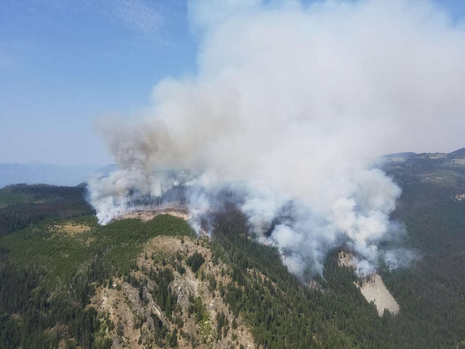 A Fire Boss plane fighting the Horns Mountain Fire in Ferry County crashed Tuesday afternoon, but the pilot survived.   Pictured is the Cougar Creek fire, which started on July 28, 2018. The estimated containment date of the 10,834-acre fire is Sept. 15, 2018. Photo: Inciweb
