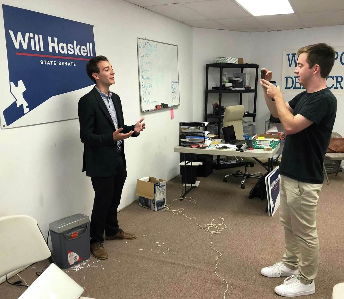 Will Haskell, the Democratic candidate for the 26th state senate district, films a video in the Democratic campaign office in Westport with his campaign manager, Jack Lynch, on July 31.