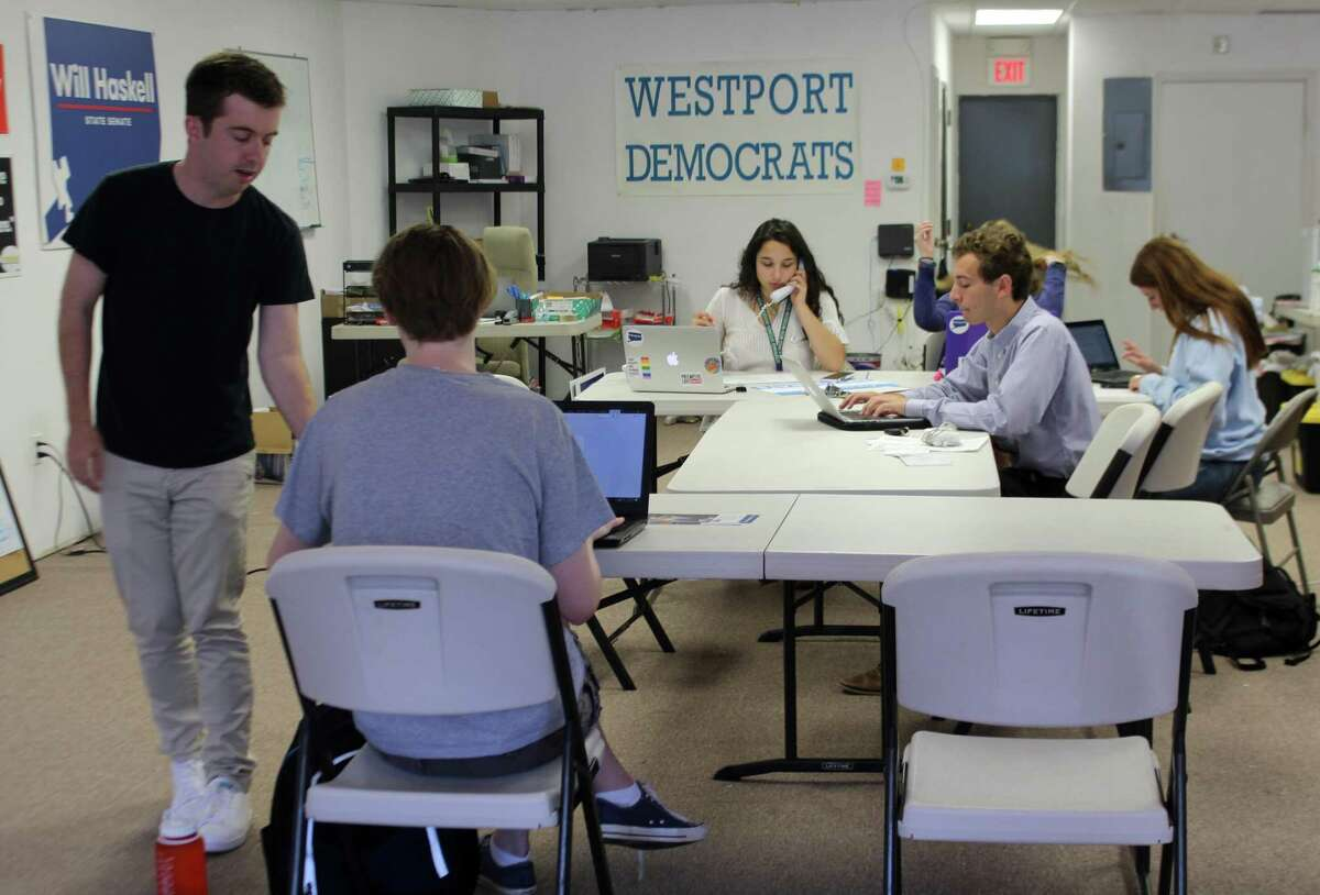 Will Haskell, the Democratic candidate for the 26th state senate district, works in the Democratic campaign office in Westport with his campaign manager and interns on July 31