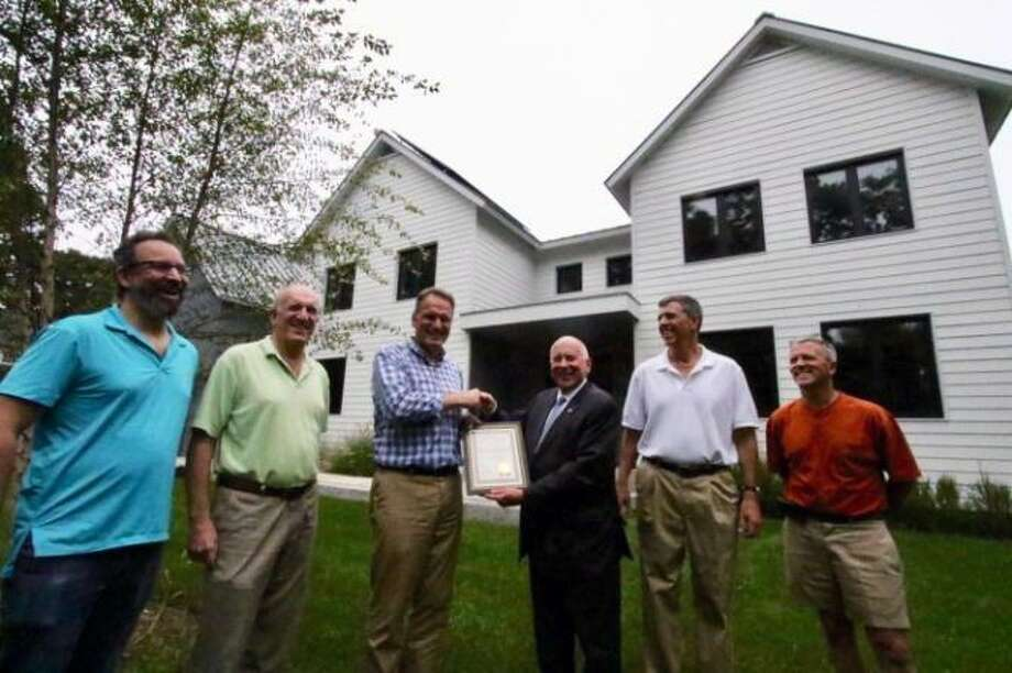 From left, Green Task Force Chairman David Mann, Westport building official Stephen Smith, homewoner Alfred Popken, First Selectman James Marpe, architect John Rountree and builder Chris Trolle outside 54 North Ave. in Westport, which recently won the Westport Green Building Award. Photo: Contributed Photo