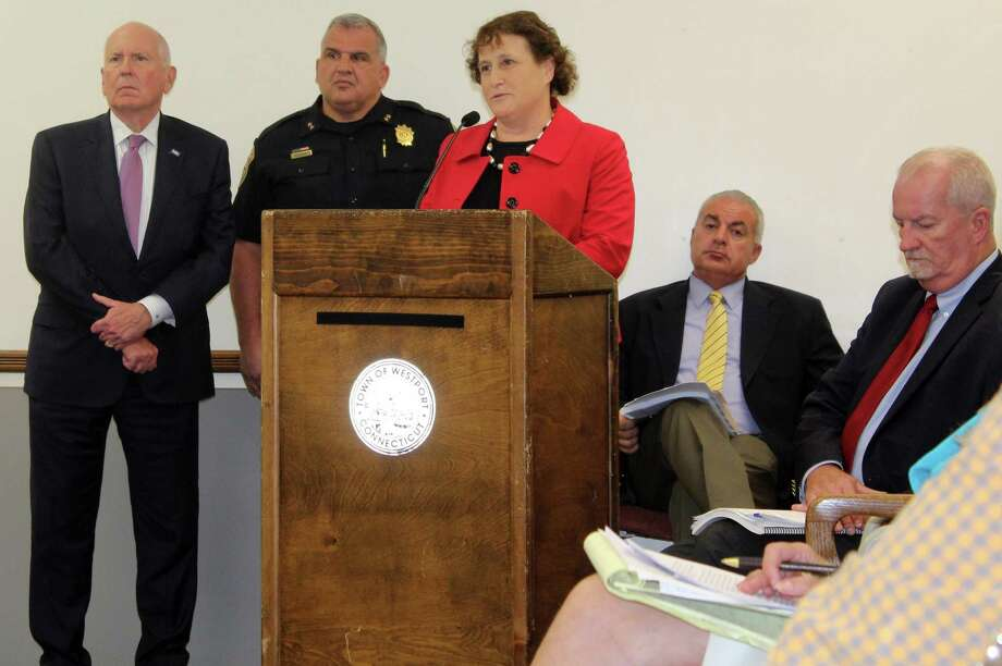 Board of Education Secretary Elaine Whitney spoke in favor of an appropriation for two school resource officers along with First Selectman Jim Marpe, left, and Police Chief Foti Koskinas. Photo: Sophie Vaughan / Hearst Connecticut Media / Westport News
