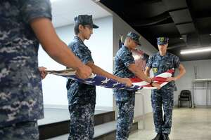 Navy Sea Cadets demonstrate flag folding during the Texans Embracing America's Military new recruit send-off ceremony at the VFW 9182, Katy, on Sunday, Aug. 5.