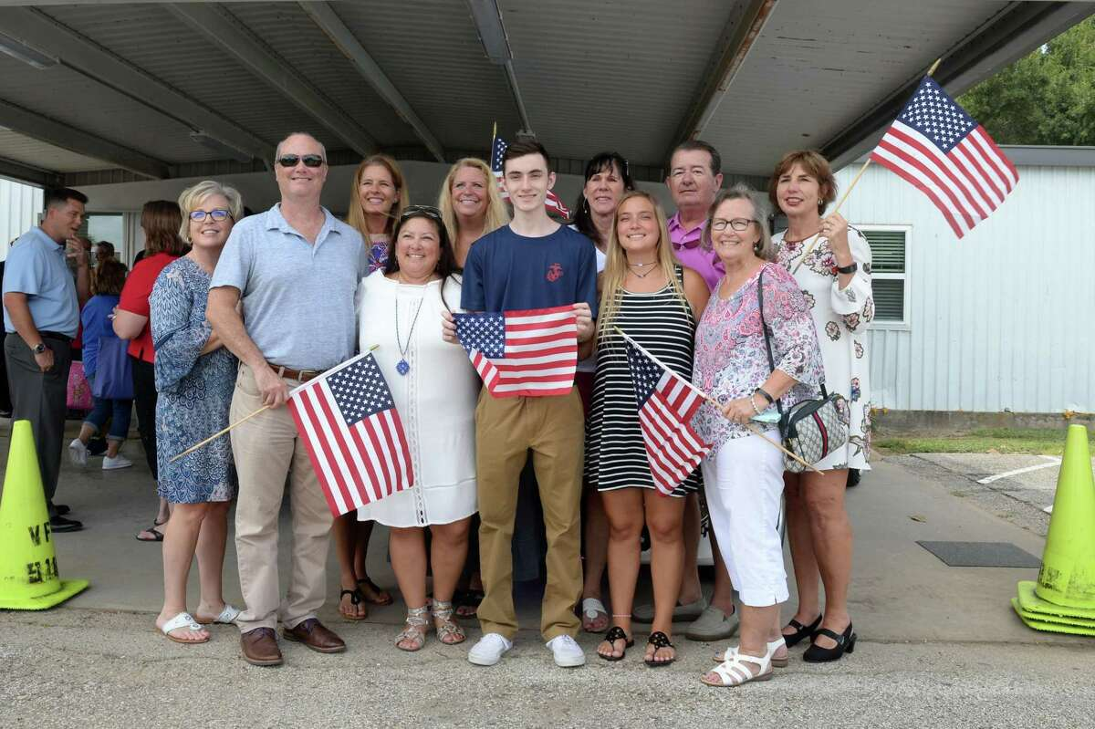 Marine Corps recruit Hayden Courville and his family pose together following the Texans Embracing America's Military send-off ceremony at the VFW 9182, Katy, TX, on August 5, 2018
