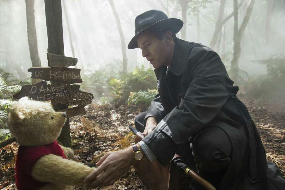 "This image released by Disney shows Ewan McGregor in a scene from ""Christopher Robin."" Photo: Laurie Sparham / Associated Press / © 2018 Disney Enterprises, Inc. All Rights Reserved."