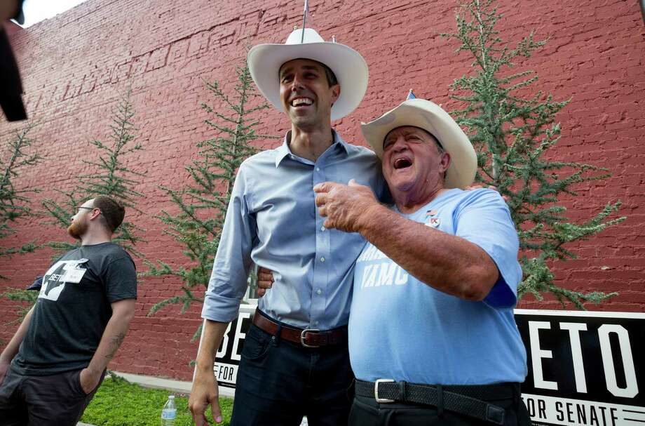 "Army veteran Rick Organ, 74, has his photo taken with Beto O'Rourke after the ""Beers With Beto"" event at the Six Car Pub & Brewery Tuesday, July 31, 2018, in Amarillo, Texas. Photo: Godofredo A. Vasquez / 2018 Houston Chronicle"
