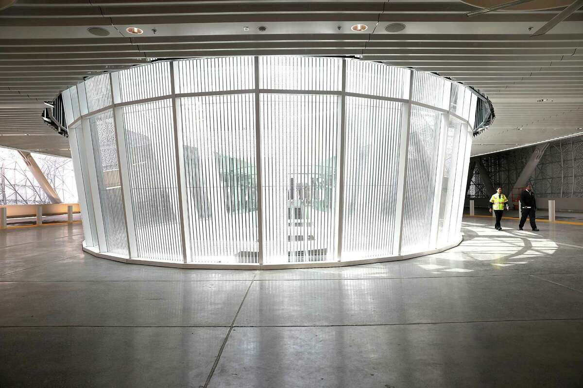 View of the digital text display by Jenny Holzer encircling the atrium of the Grand Hall