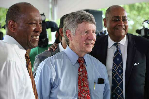 Houston Mayor Sylvester Turner, from left, Harris County Judge Ed Emmett, Harris County Commissioner Rodney Ellis pose for a photograph after a press conference to rally for Proposition A in the upcoming Harris County Flood Control District Bond Election on the banks of White Oak Bayou at TC Jester Park on Thursday, Aug. 9, 2018, in Houston. The Harris County leaders ask county residents to vote for the $2.5 billion bond proposal to help finance a 10- to 15-year program of flood mitigation projects.