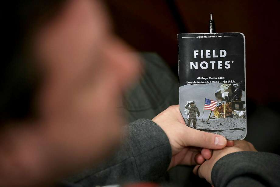 A man holds a space-themed notebook at a speech in Arlington, Va., where Vice President Mike Pence announced that the U.S. plans to create a Space Force branch of the military. Photo: Chip Somodevilla / Getty Images