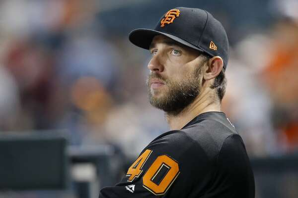 San Francisco Giants starting pitcher Madison Bumgarner pauses in the dugout prior to a baseball game against the Arizona Diamondbacks Friday, Aug. 3, 2018, in Phoenix. (AP Photo/Ross D. Franklin)