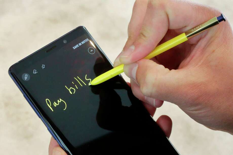 The Samsung Galaxy Note 9 and stylus are shown in this photo, in New York, Tuesday, Aug. 7, 2018. The stylus, a signature Note feature, will now have Bluetooth capability, allowing people to control phones and apps from up to 30 feet away. (AP Photo/Richard Drew) Photo: Richard Drew / Copyright 2018 The Associated Press. All rights reserved