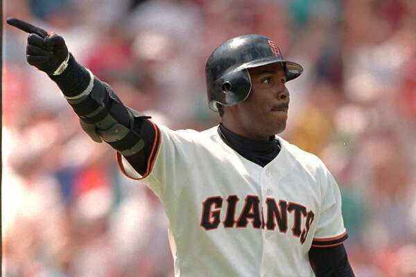 San Francisco Giants Barry Bonds points after hitting a home run with two outs in the bottom of the ninth inning against the Florida Marlins to tie their game at seven runs apiece at Candlestick Park in San Francisco, Tuesday July 18, 1995. The Marlins won the game in the 14th inning, 12-10. (AP Photo/Eric Risberg)