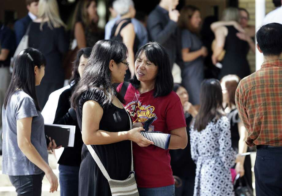 Mourners gather outside after the memorial service for Chinese United Methodist Church Pastor Chengju Huo and his wife Huixiang on August 9, 2018. Photo: Tom Reel, Staff / Staff Photographer / 2017 SAN ANTONIO EXPRESS-NEWS