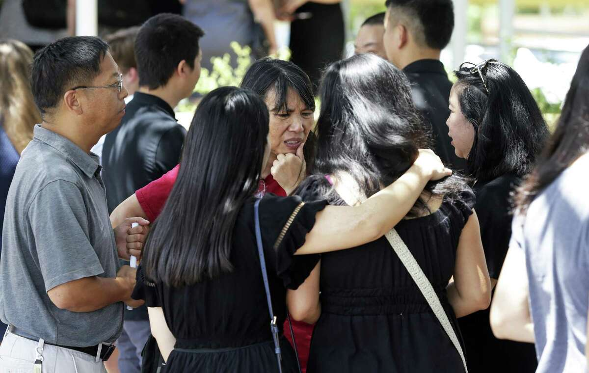 Mourners gather outside after the memorial service for Chinese United Methodist Church Pastor Chengju Huo and his wife Huixiang on August 9, 2018.