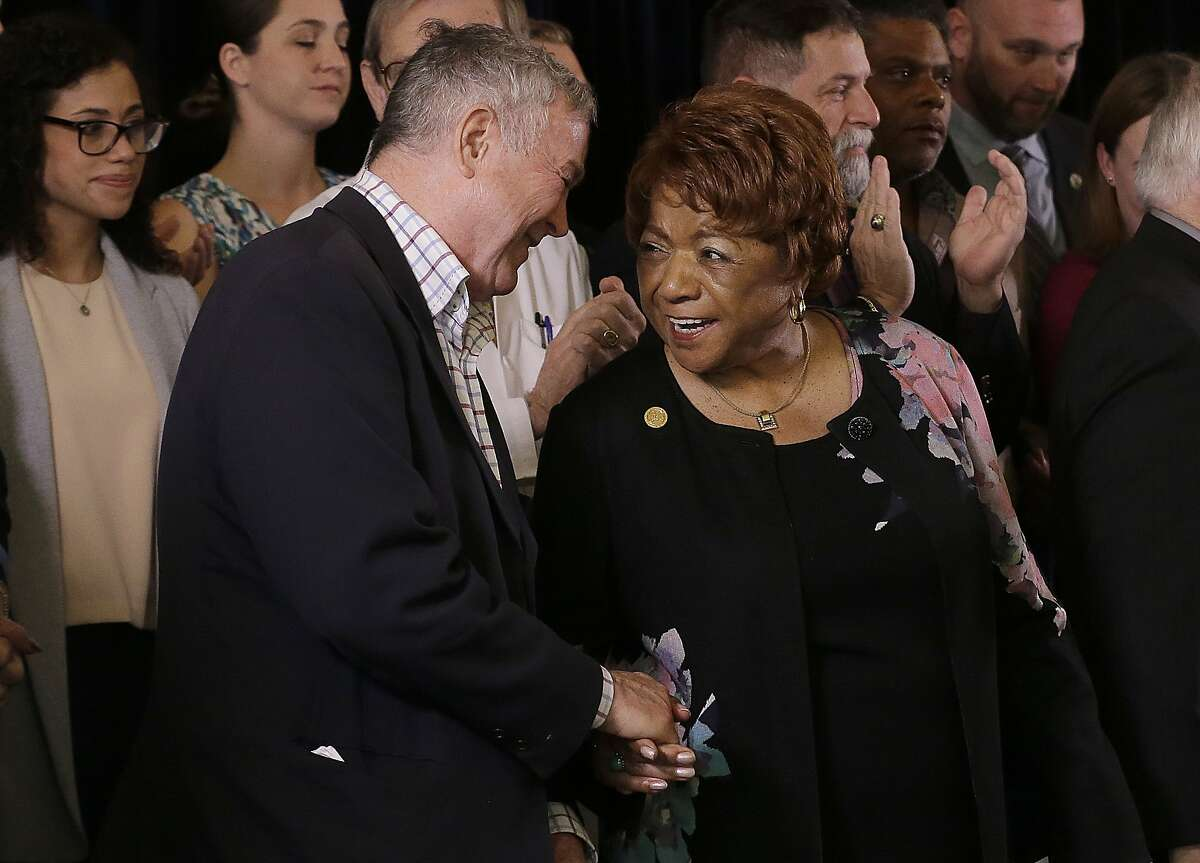 Rep. Dana Rohrabacher, R-Calif., left, shakes hands with Alice Huffman, President of the California NAACP, after speaking at a news conference in support of the Adult Use of Marijuana Act ballot measure in San Francisco, Wednesday, May 4, 2016. Backers of the marijuana legalization initiative said Wednesday they have collected enough signatures for the measure to qualify for the November ballot in California.