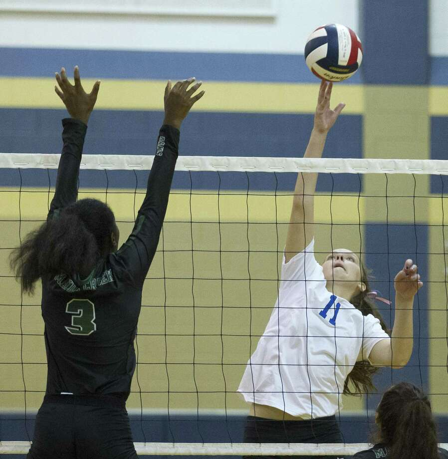 Oak Ridge's Savanna Meyer (11) gets a shot past Mayde Creek's Jaiden Chretien (3) in the first set of a match during the Katy/Cy-Fair Volleyball Classic at Cypress Ranch High School on Thursday, Aug. 8, 2018, in Cypress. Oak Ridge defeated Mayde Creek 2-0. Photo: Jason Fochtman, Staff Photographer / Houston Chronicle / © 2018 Houston Chronicle
