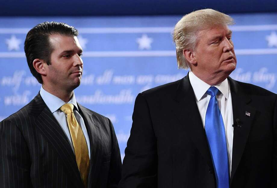 """Republican presidential nominee Donald Trump stands with his son Donald Trump Jr. after the first presidential debate at Hofstra University in Hempstead, New York in 2016. President Trump denied on July 27, 2018, knowing about a 2016 meeting between top members of his election campaign team and a Russian lawyer, disputing reported claims by his former attorney, Michael Cohen. """"I did NOT know of the meeting with my son, Don jr,"""" Trump said in a tweet. Photo: JEWEL SAMAD /AFP /Getty Images / AFP or licensors"""