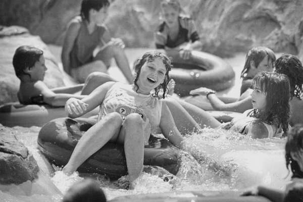 FROM THE ARCHIVES: Visitors of Water Wonderland enjoyed the water rides in the 100-degree plus heat while other members of society didn't care too much for the weather. June 10, 1988