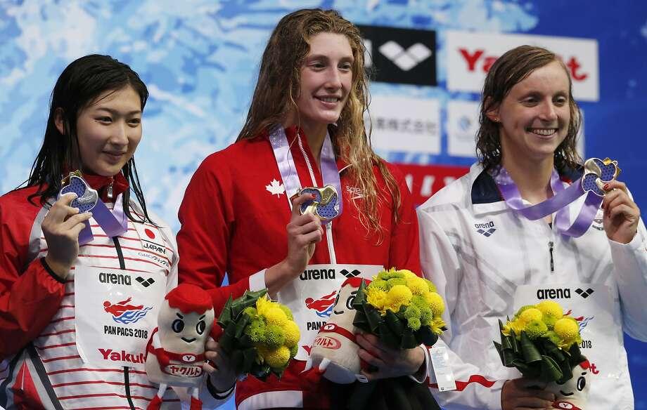 Canada's Taylor Ruck (center) won the women's 200-meter freestyle ahead of Japan's Rikako Ikee (left) and Katie Ledecky. Photo: Shuji Kajiyama / Associated Press
