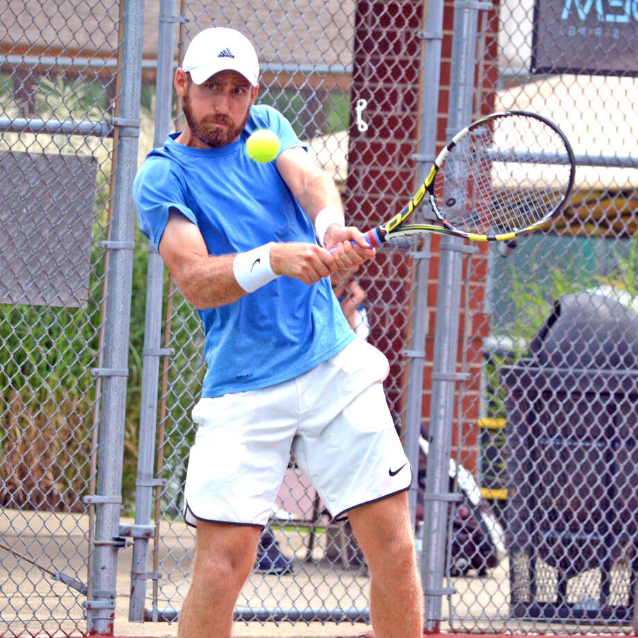 Nicholas Meister makes a backhand return during his doubles semifinal at the USTA Edwardsville Futures on Thursday. Photo: Scott Marion