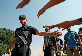 Golden State Warriors' Stephen Curry slaps hands with fans during 1st round of Ellie Mae Classic at TPC Stonebrae in Hayward, Calif. on Thursday, August 9, 2018.