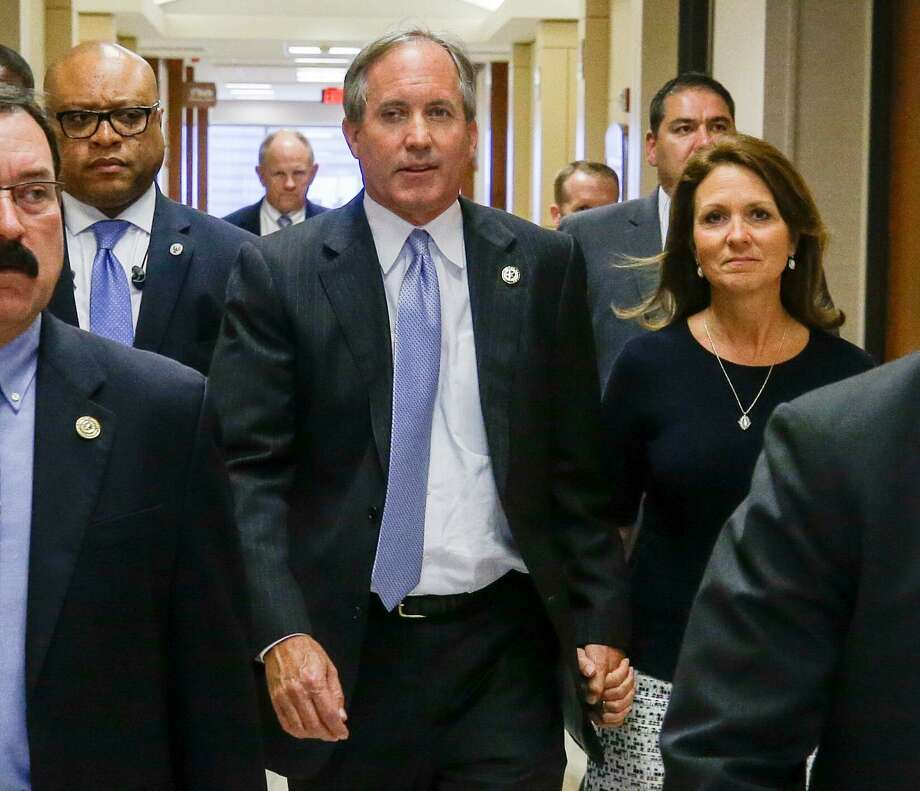 Texas Attorney General Ken Paxton and his wife Angela Paxton, arrive for a hearing in the Harris County Criminal 177th District Court of Judge Robert Johnson Thursday, July 27, 2017. ( Melissa Phillip / Houston Chronicle ) Photo: Melissa Phillip, Staff / Melissa Phillip / Houston Chronicle 2017