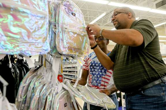 Darryl Whitfield (right) and his son, Glenn Whitfield, 17, a junior at Madison, shop for clear backpacks at OfficeMax, 17700 US Hwy 281 N, on Thursday, Aug. 9, 2018.  NEISD has mandated that all student backpacks be clear at every high school and middle school in the district beginning in the fall of the 2018-2019 school year.