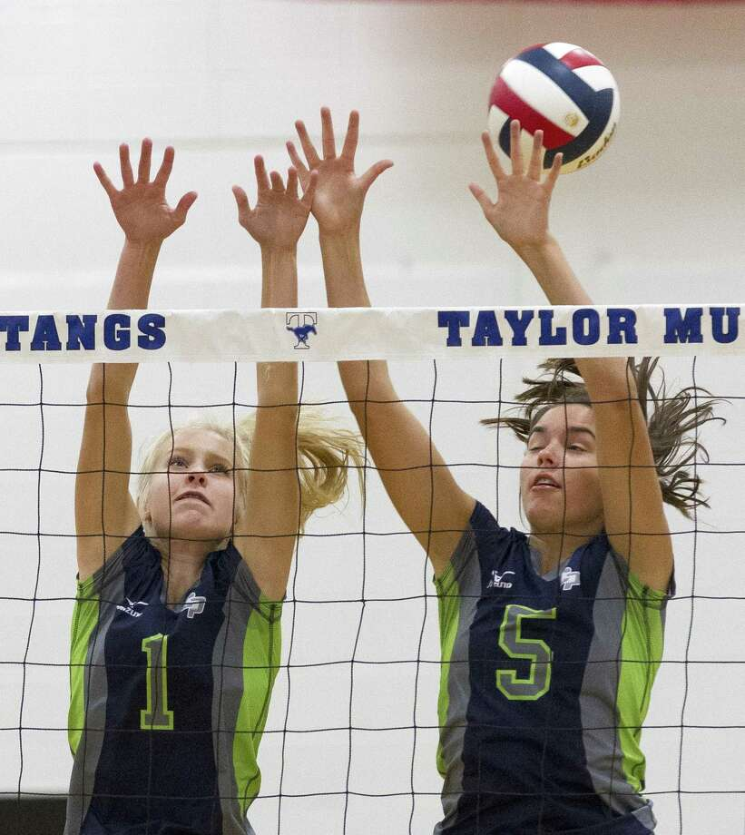 College Park's Parker Pogue (1) and Abby Kremer (5) block a shot in the first set of a match during the Katy/Cy-Fair Volleyball Classic at Katy Taylor High School on Thursday, Aug. 8, 2018, in Katy. Photo: Jason Fochtman, Staff Photographer / Houston Chronicle / © 2018 Houston Chronicle