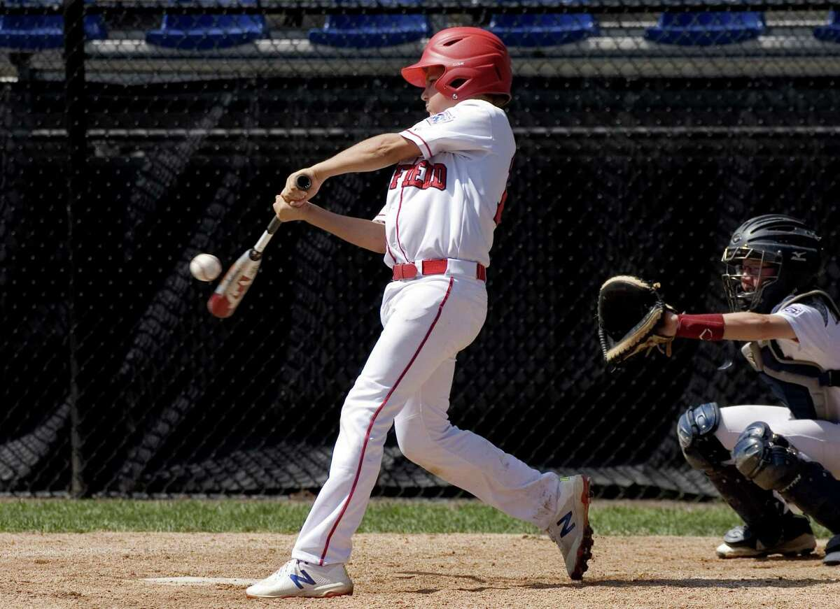 Fairfield American's Charlie Yates gets a hit against New Hampshire on Thursday in Bristol.