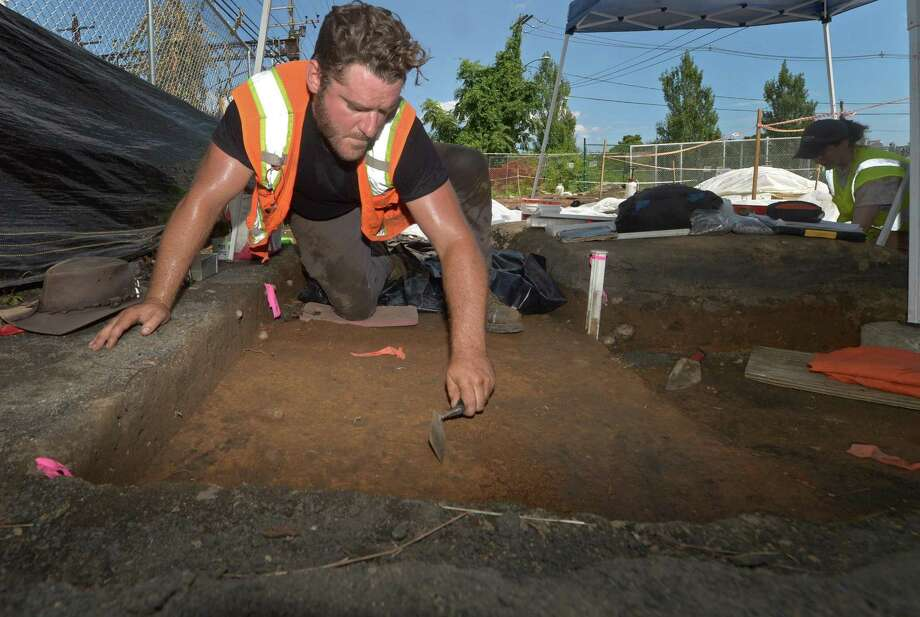 Archeologists with Archeological and Historical Services including Ben Kelsey work diligently following the Connecticut Department of Transportation press conference on the archeological dig Thursday, August 9, 2018, at the Walk Bridge construction site in Norwalk, Conn. The dig uncovered rare Native American artifacts including some that date back thousands of years. Photo: Erik Trautmann / Hearst Connecticut Media / Norwalk Hour